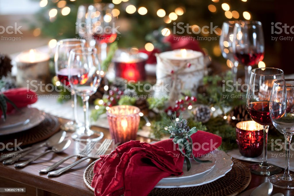 Christmas holiday dining table elegant place setting. Very shallow...