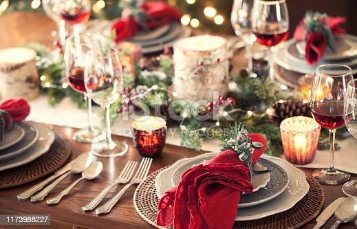 Christmas holiday dining table elegant place setting. Very shallow depth