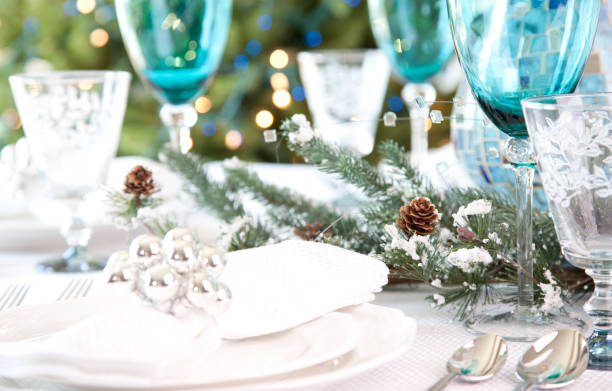 christmas holiday dining table in blue - blue table setting stock photos and pictures