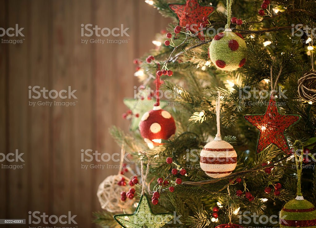 Christmas Holiday Eco friendly tree, natural ornaments, wood door background stock photo