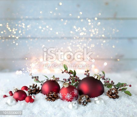 Christmas holiday baubles festive and sparkling lights against an old wood background