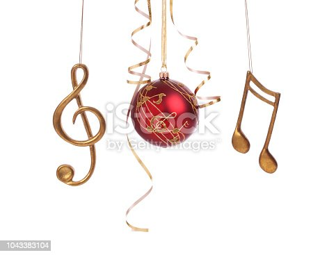 Christmas holiday set of elegant musical baubles and decorations with curled gold ribbon isolated on white