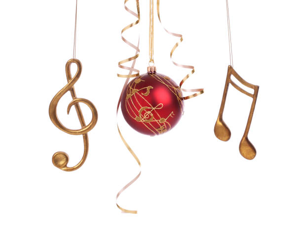 Christmas holiday elegant music bauble and decorations isolated on white Christmas holiday set of elegant musical baubles and decorations with curled gold ribbon isolated on white musical note stock pictures, royalty-free photos & images