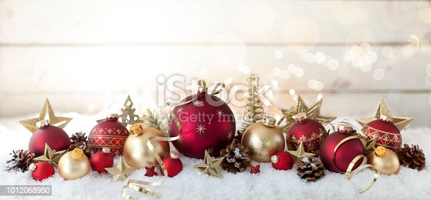 1020742072istockphoto Christmas Holiday Festive Baubles against an Old Wooden Background 1012068950