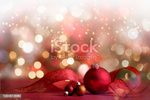 Christmas Holiday Festive Baubles with Ribbon and defocused Lights Background