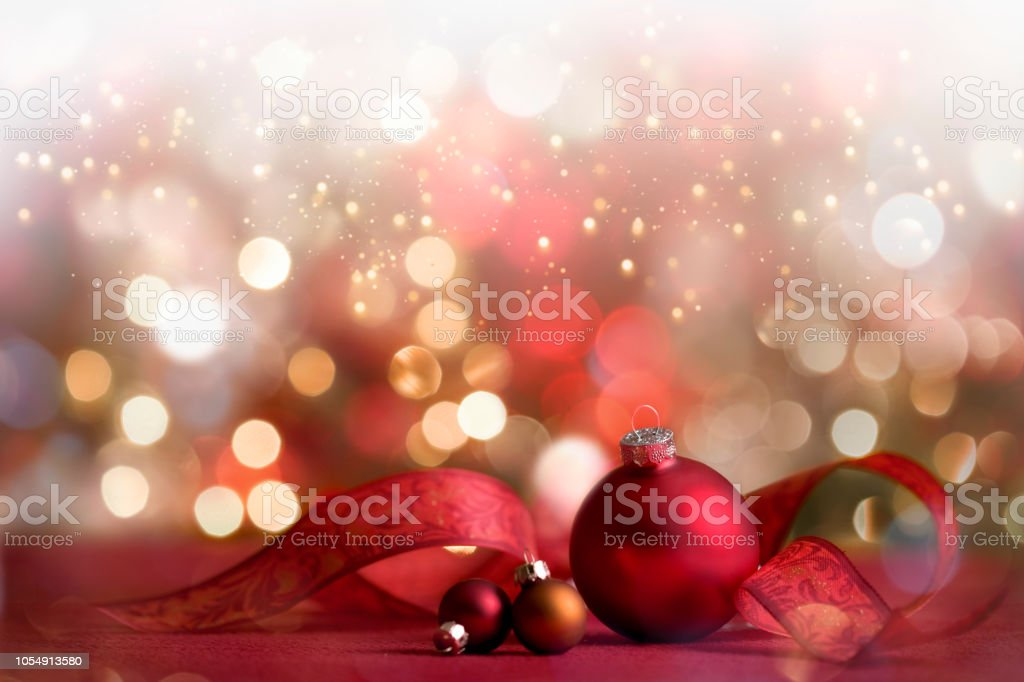 Christmas Holiday Festive Baubles with Ribbon and defocused lights stock photo