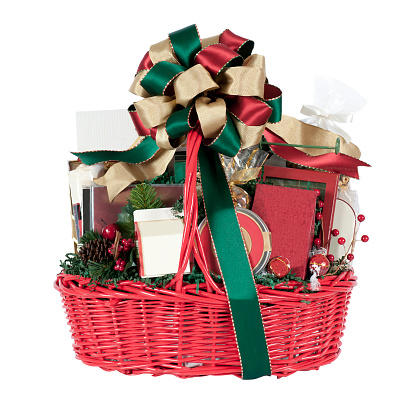 Holiday gift basket filled with a variety of goodies. Isolated on white.