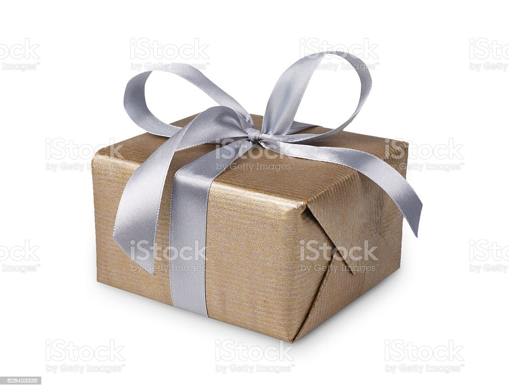 Christmas holiday gift box in golden paper isolated on white stock photo