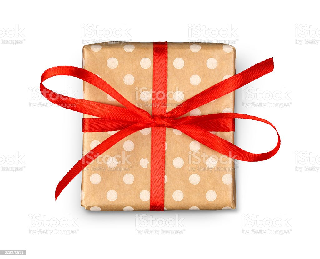 Christmas holiday gift box in spotted paper isolated on white - foto de stock