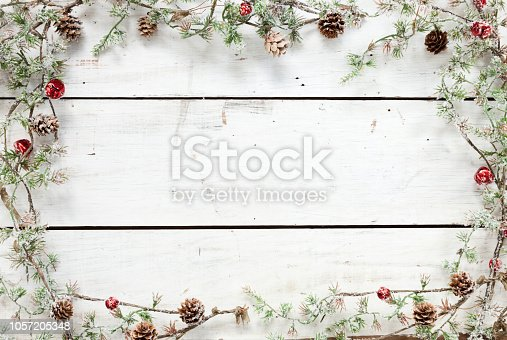 Christmas holiday pine wreath garland on a white wood background