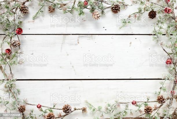 Christmas holiday pine wreath garland wood background picture id1057205348?b=1&k=6&m=1057205348&s=612x612&h=0djm  ua4ee9f x8osjem0xjbm pscrh23iq55lbofg=
