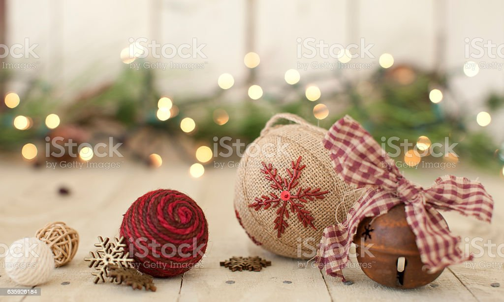 Christmas Holiday Rustic Bell, Baubles and Candle on Wood Background stock photo