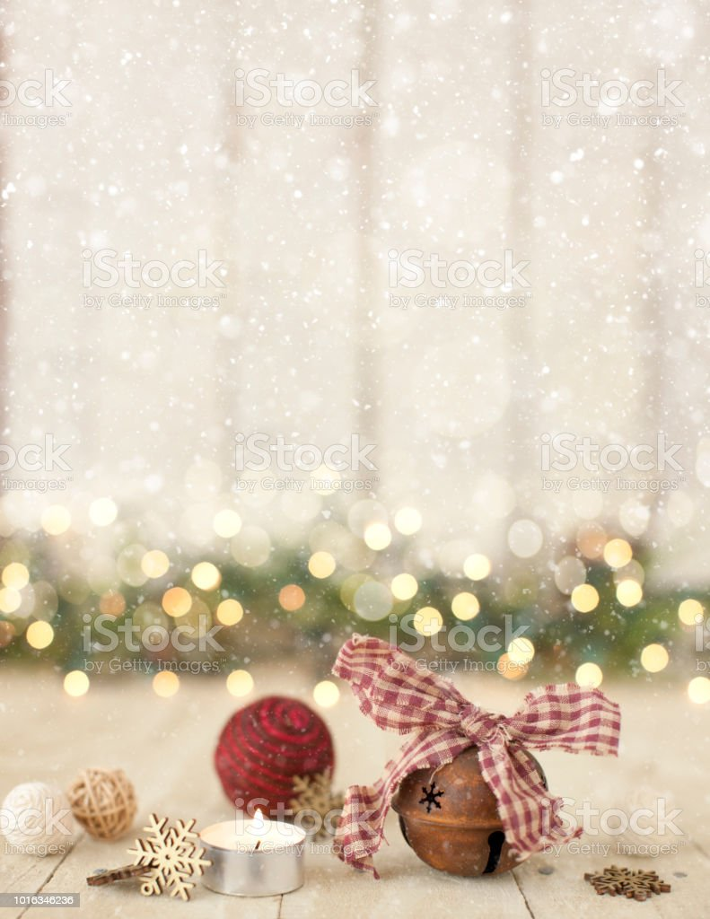Christmas holiday rustic, natural fiber ornaments on an old wood background stock photo