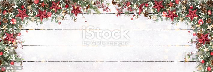 istock Christmas Holiday Wreath Garland Border on Old Wood Background 1048373240
