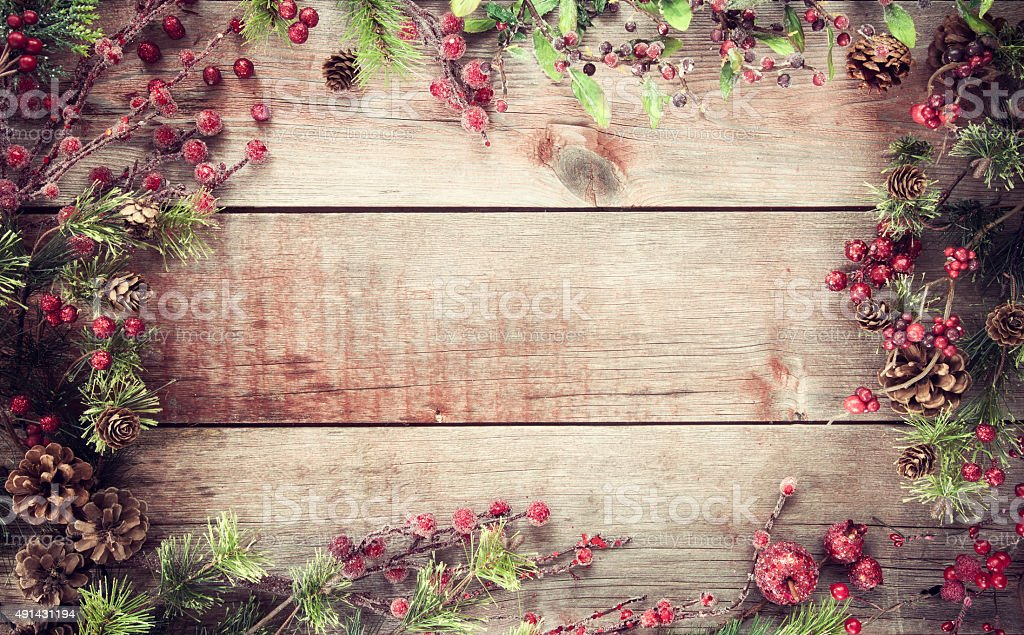 Christmas Holiday Wreath Garland on Old Rustic Wood Background stock photo