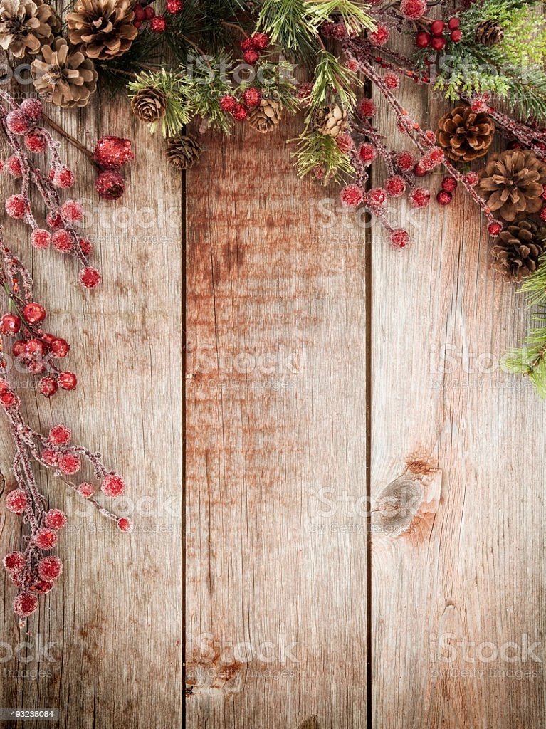 Christmas holiday wreath garland on old rustic wood