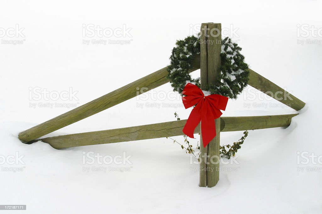 Christmas Holiday Wreath With Bow On Fence royalty-free stock photo