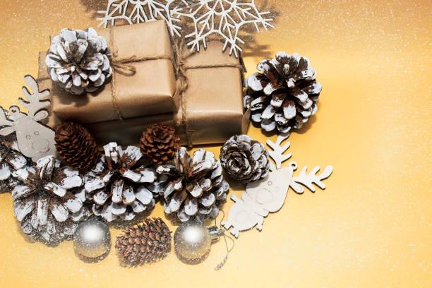 Christmas holidays composition on gold paper background picture id1175067263?b=1&k=6&m=1175067263&s=612x612&w=0&h=8f3eu3pdojgsbxznpri7mn7 zzgftwuqppczu2jdxbu=