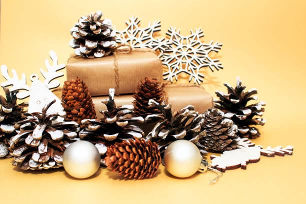 Christmas holidays composition on gold paper background picture id1175067265?b=1&k=6&m=1175067265&s=612x612&w=0&h=o so6xdgqy g4sx lpgt8wnqks4jzgkagwzcmwkwpli=