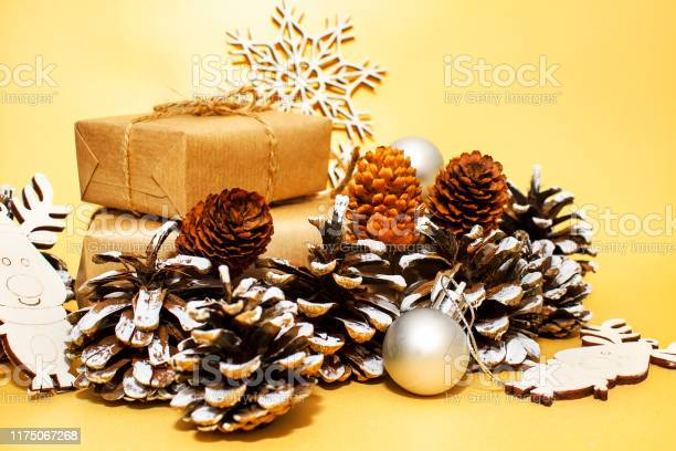 Christmas holidays composition on gold paper background picture id1175067268?b=1&k=6&m=1175067268&s=612x612&h=mpzclcq8hrfzqbnlfoyihwnopvl8x0k9ps9jm4jjtwk=