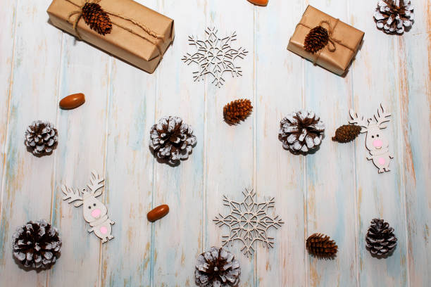 Christmas holidays composition on white wooden background craft boxes picture id1163546027?b=1&k=6&m=1163546027&s=612x612&w=0&h=pyfwy wxaxfkevmm9oo9n27s 9zc6q1vrbxyijfs45q=