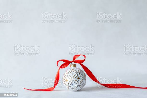 Christmas holidays composition with white ball and red ribbon on picture id1188366602?b=1&k=6&m=1188366602&s=612x612&h=5q0mvejt avazayzultcct2rtkoqdmtzet6nzabldce=