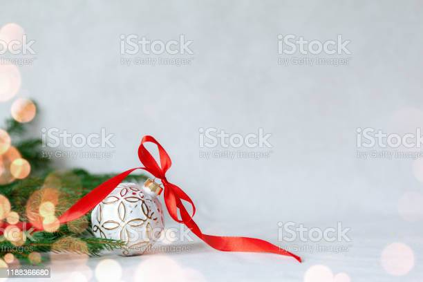 Christmas holidays composition with white ball and red ribbon on picture id1188366680?b=1&k=6&m=1188366680&s=612x612&h=qfhhdmxlan7qadxb71fwuijyvfbkxpwku0rr3jkvjne=