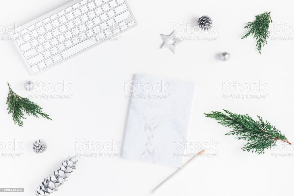 Christmas home office desk with computer, notebook, pine branches,...