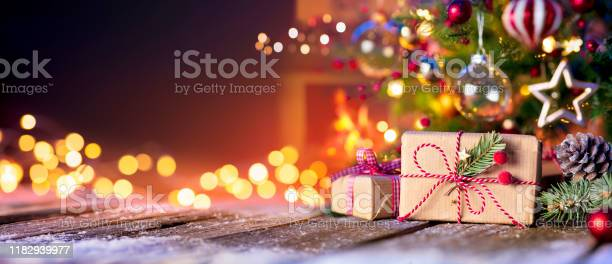 Christmas home room gift box below tree with lights and fireplace picture id1182939977?b=1&k=6&m=1182939977&s=612x612&h=golq7thwaj omtalsloqpvaf4rcbt1abmuiayqae7l4=