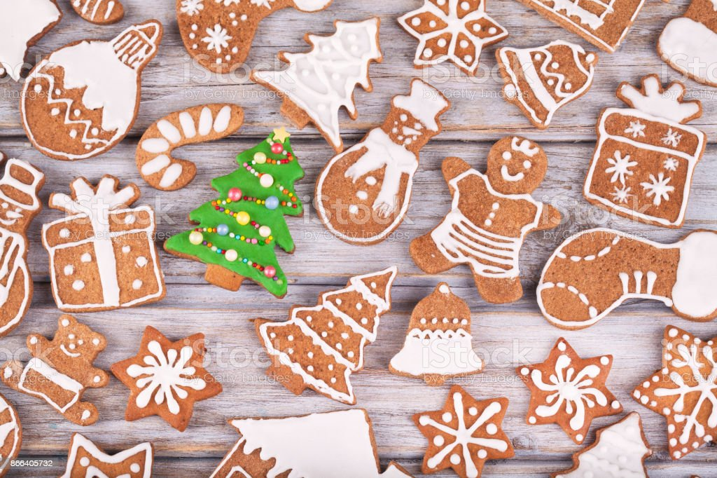 Christmas homemade gingerbread cookies on white wooden white rustic table stock photo
