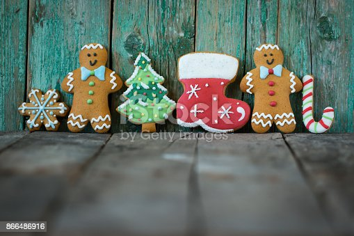 istock Christmas homemade gingerbread cookies on wooden table 866486916