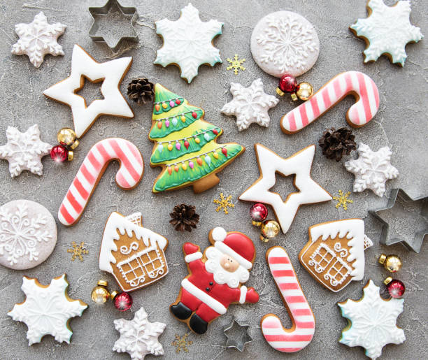 Christmas homemade gingerbread cookies Christmas homemade gingerbread cookies on a concrete background cookie stock pictures, royalty-free photos & images