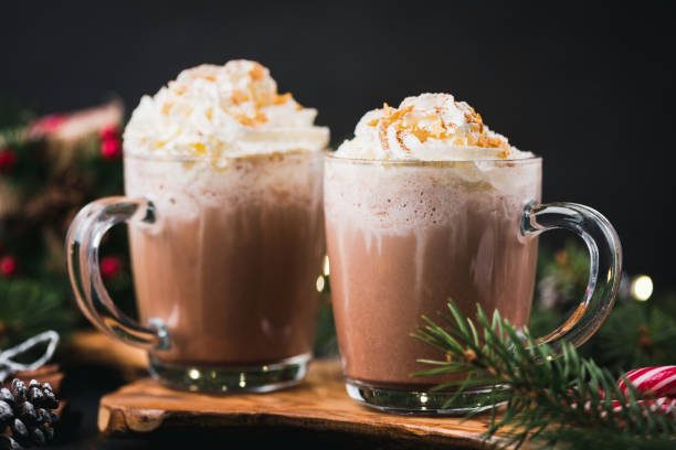 christmas hot chocolate with whipped cream - hot chocolate stock photos and pictures
