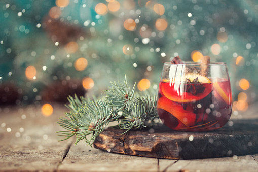 christmas hot mulled wine with cinnamon cardamom and anise on wooden background