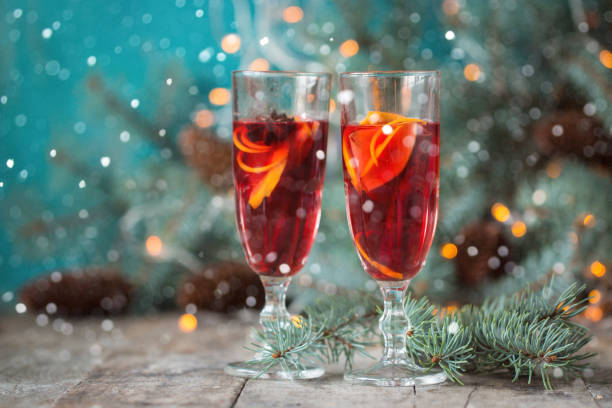 christmas hot mulled wine with cinnamon cardamom and anise on wooden background stock photo
