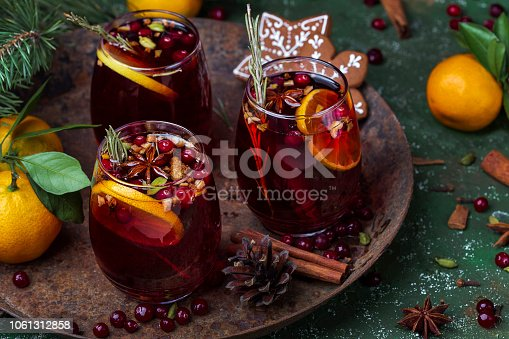 istock Christmas hot mulled wine with spices and fruits 1061312858