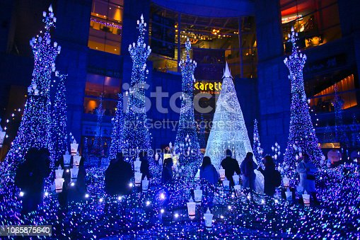 Tokyo, Japan - December 12, 2017 : People watching the Christmas Illumination in front of the Caretta Shiodome in Tokyo, Japan.