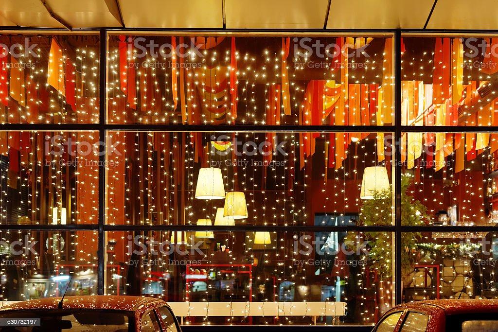 Christmas illumination of restaurant window stock photo