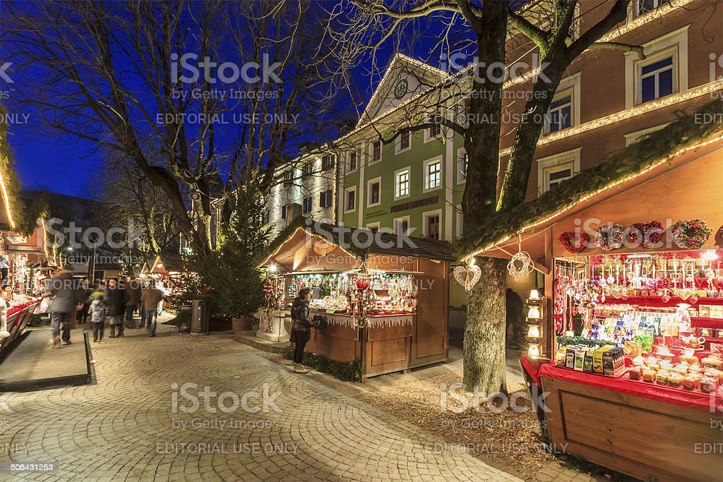 Christmas in Brunico/Bruneck, Italy Brunico, Italy - December 16, 2013: People at the traditional Christmas market in the old town of Brunico. Architecture Stock Photo