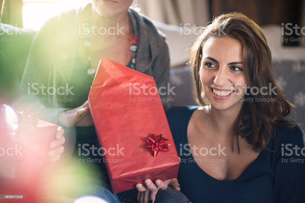 Christmas in mountain house: Family giving presents stock photo