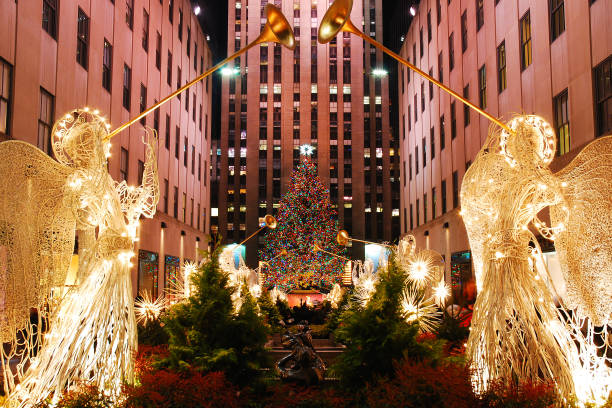 Christmas In New York New York, NY, USA December 17, 2006 Lighted angels, playing a tympany, frame the famed Christmas tree in Rockefeller center in New York City december stock pictures, royalty-free photos & images