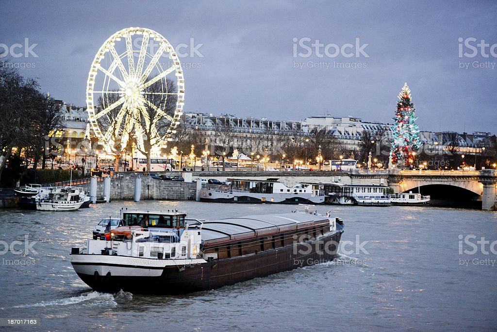 Christmas in Paris. Boat on Seine River stock photo