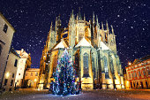 St. Vitus Cathedral in Prague on a snowy Christmas evening.