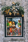 Salburg, Austria - December 25, 2015: Christmas decorations showcase with souvenirs, toys and books