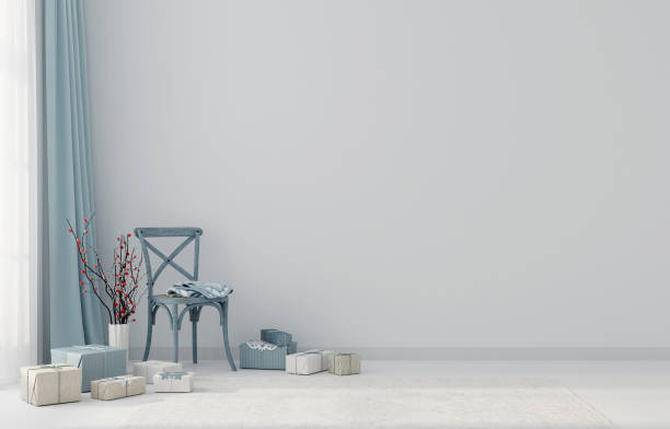 Christmas interior with a blue chair and gifts stock photo