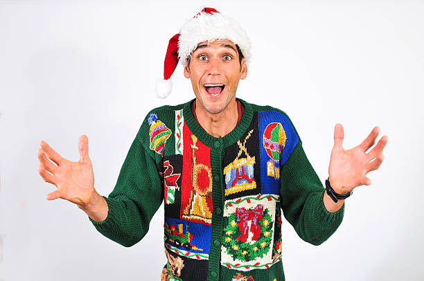 Christmas is comming A young man in an ugly sweater is excited about Christmas. Studio shot with copy space. ugliness stock pictures, royalty-free photos & images