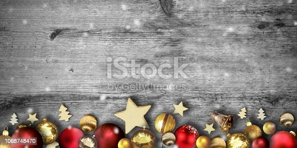 istock Christmas items on wood background 1068748470