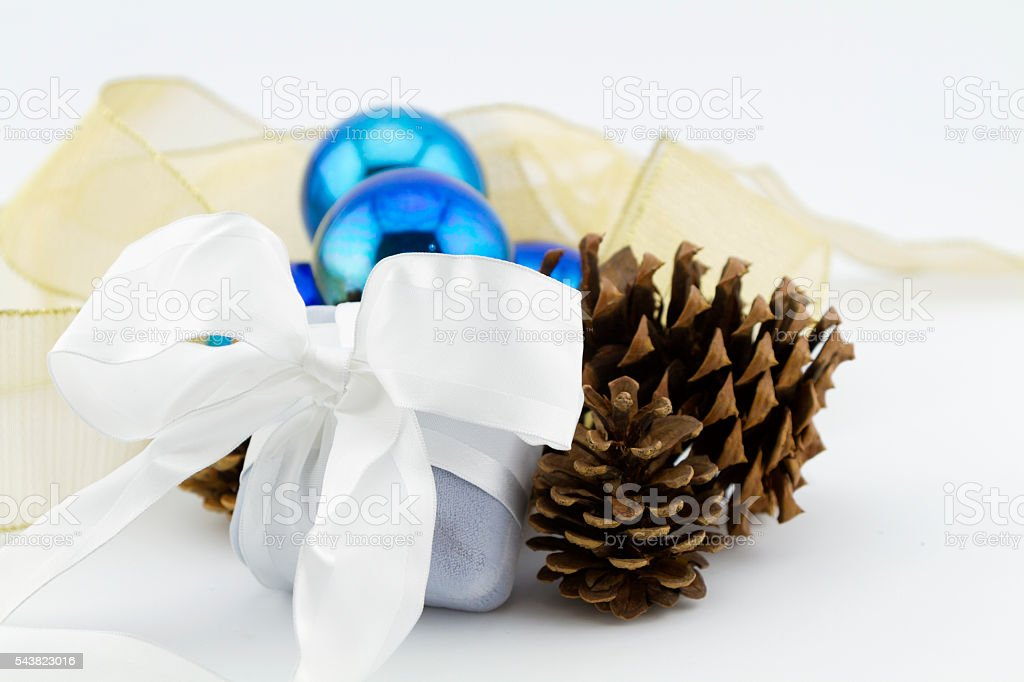 Christmas jewelry gift with ribbons and blue glass balls stock photo