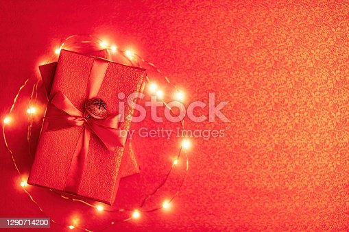 Christmas  jingle bell and gift boxes on red with space for your text.