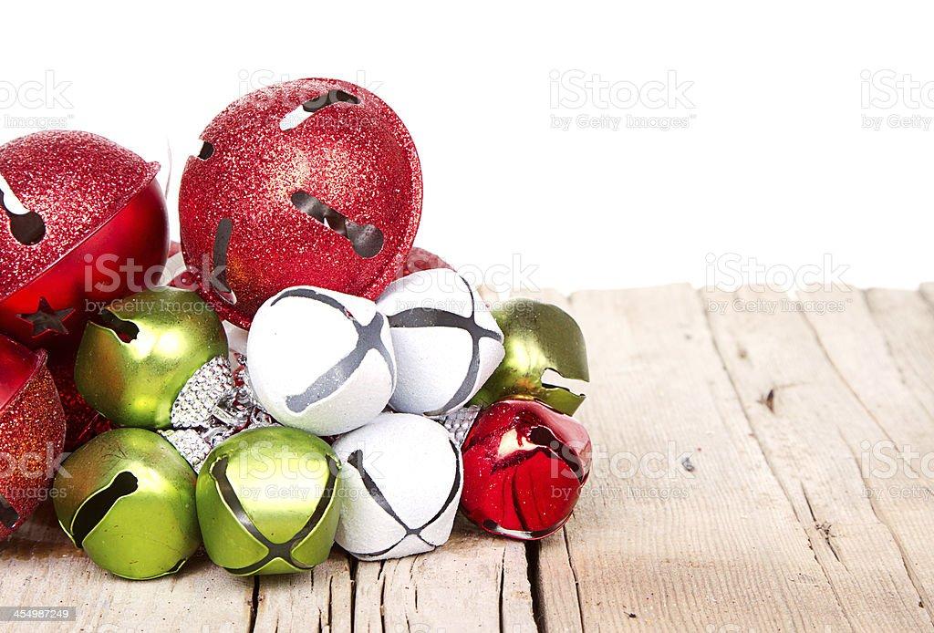 Christmas jingle bells on a  plank stock photo